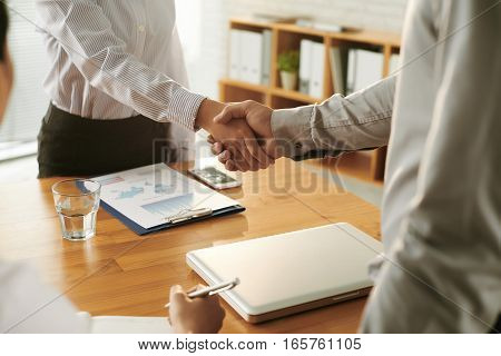 Two business partners shaking hands before meeting