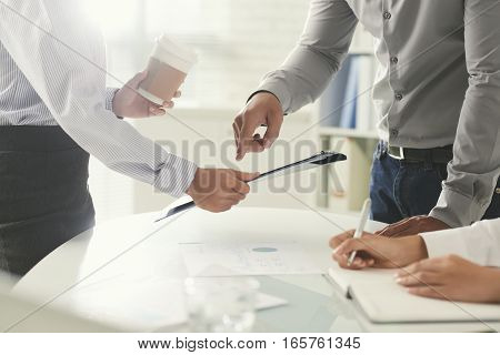 Cropped image of business colleagues working together in office