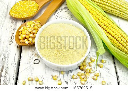 Flour Corn In Bowl With Spoons On Board