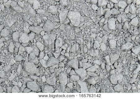 aggregate of glauconite sandstone - gray gravel that has been crushed at a stone pit, consisting of larger coarse stones and smaller grit.