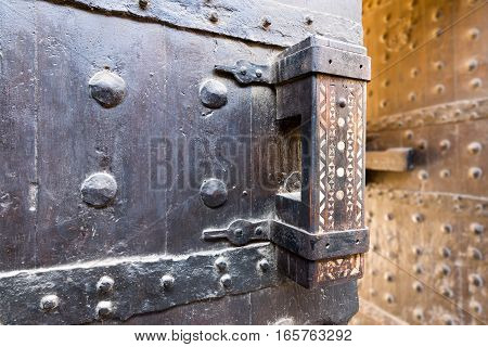 Wooden old latch of the wooden ancient gate of the caravansary (Wikala) of Bazaraa Cairo Egypt