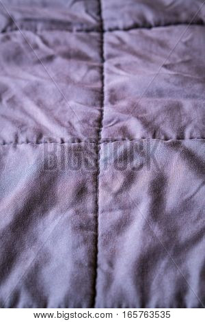 Rumpled brown quilt textile background structure pattern