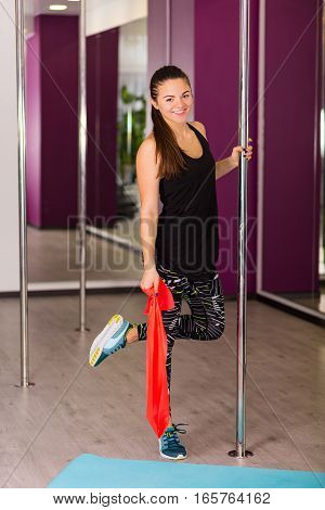 Woman In The Fitness Studio