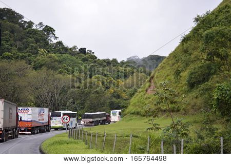 Rio de Janeiro Brazil - january 15 2017: Presidente Dutra Highway congested due to traffic in half lane near the Araras mountain range