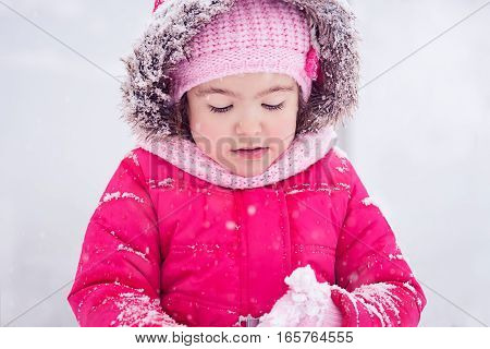 Snow Fairytale with little girl in the park