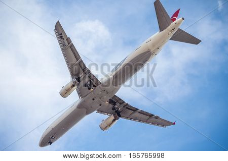 ISTANBUL TURKEY - March 13 2015: Turkish Airlines Boeing at Floria. Under view of an airplane coming into land on March 13 2015 in Istanbul Turkey.