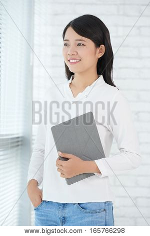 Lovely Asian business lady with digital tablet