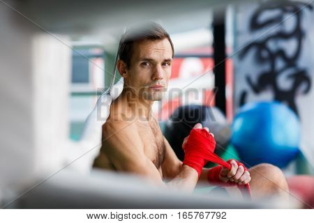 Photo of young man close-up near boxing ring