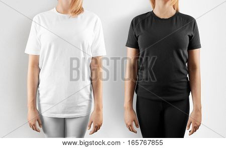 Blank black and white t-shirt design mockup, isolated. Women wear tshirt template, front view mock up. Empty apparel uniform singlet, female model. Plain sweat tee shirt dress set.