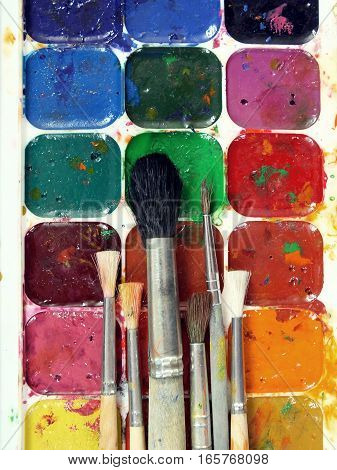 Watercolor Paints And Brushes. Stained watercolor palette