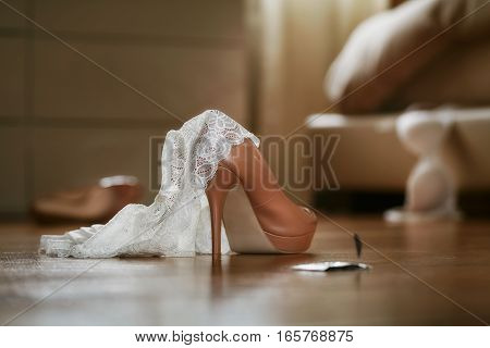 Bedroom mess with lingerie shoes and condom quick sex concept