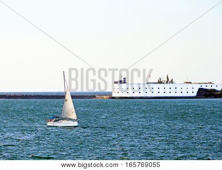 Lighthouse and yacht. Sevastopol, Crimea, Southen Ukraine