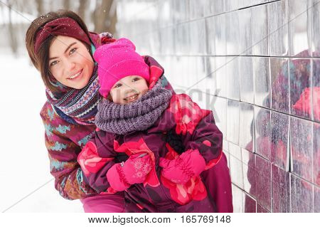 Portrait of family in winter park near building