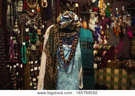 Interior of Indian shop decorated and dressed doll with jewelry and clothes.