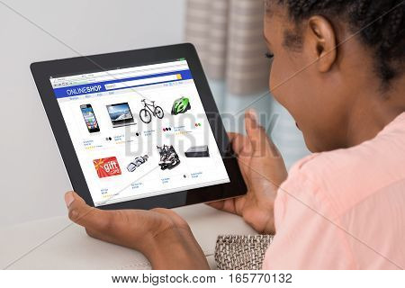 Close-up Of African Woman Doing Online Shopping On Digital Tablet At Home