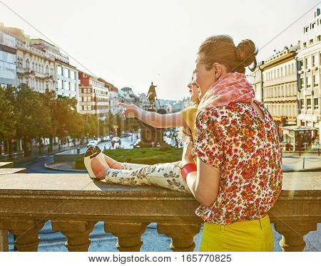 Mother And Daughter Travellers In Prague Pointing On Something
