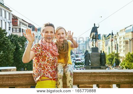 Happy Mother And Daughter Tourists Handwaving In Prague