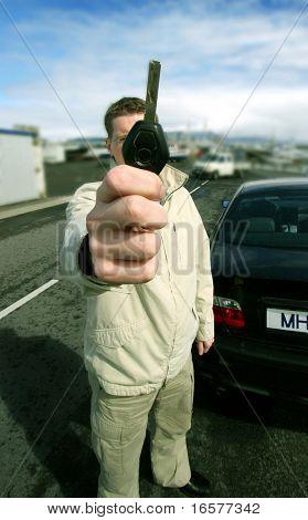 New car owner holding car key
