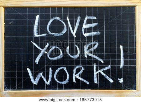 The words Love Your Work written by hand on a blackboard as a concept for employee and job satisfaction