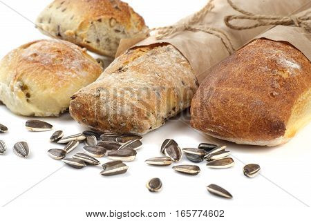 bread and sunflower kernels isolated on white background