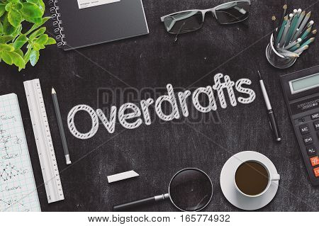 Overdrafts on Black Chalkboard-Table. Office Composition. 3d Rendering. Toned Image.