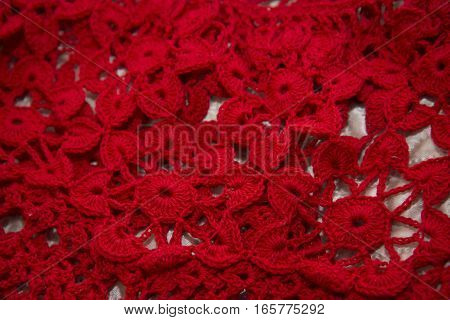 Red Cardigan Knitted In Manual Photographed In Close-up.