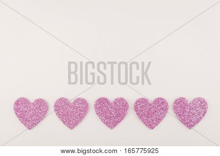big glitter pink heart decorate on white paper background