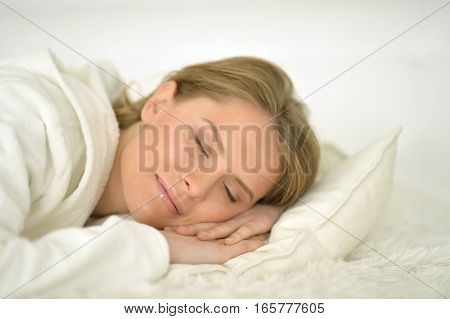 Portrait of beautiful young woman sleeping in her bed