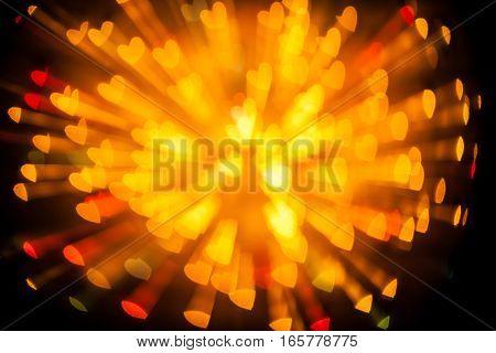 explosion of bokeh heart blur on black background