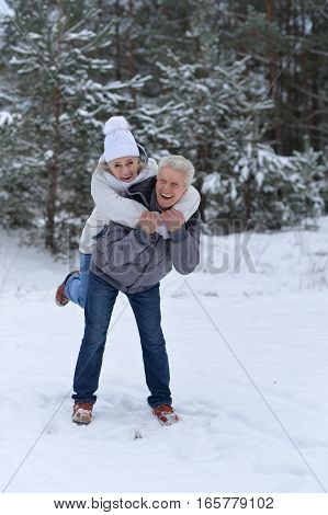 happy mature couple have fun outdoors in winter