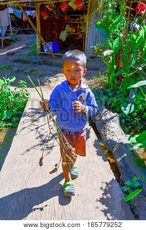 Kayan Boy In A Long-neck Hill Village In Thailand