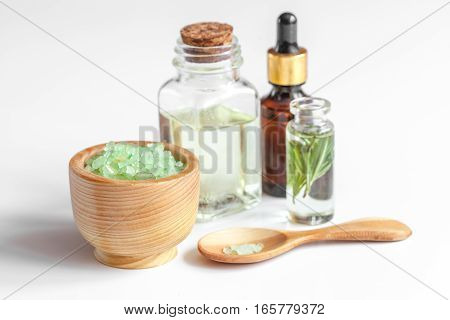 organic cosmetics with extracts of herbs - rosemary on white background