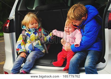 happy kids - two girls and boyl love travel by car, family car travel