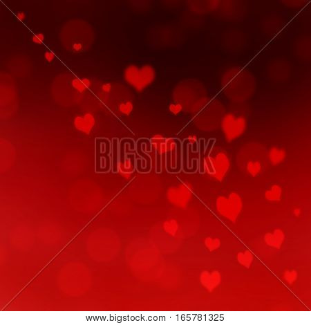bright red hearts in light bokeh red background