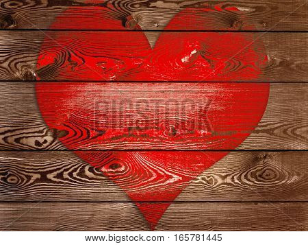 a big red heart on wooden panel