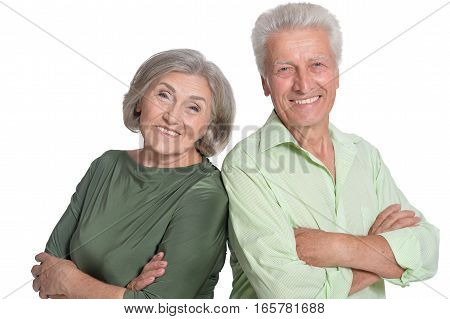 mature man and woman, posing and smiling, against white background