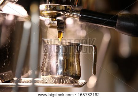 Coffee Espresso. Espresso Machine Making Coffee Golden Espresso Flowing.
