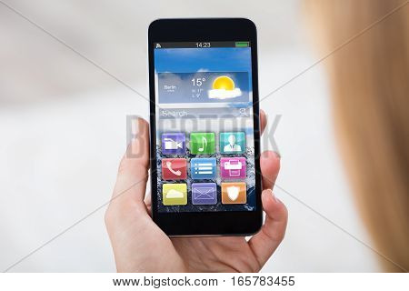 Close-up Of Woman Hand Holding Mobile Phone Showing Different Colorful Application