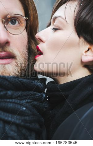 Outdoor fashion portrait of young sensual couple in cold winter wather. love and kiss. Winter love story beautiful stylish young couple.