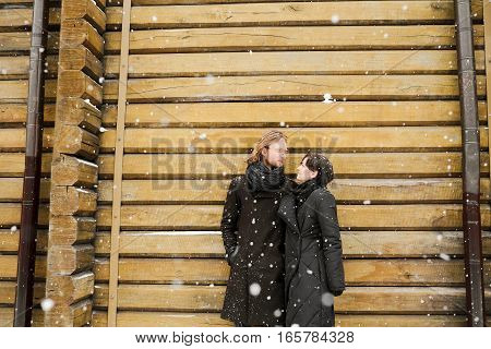 Young happy couple of lovers at beginning of love story . Winter fashion concept with boyfriend and girlfriend