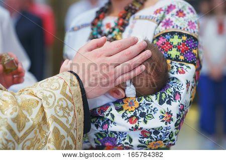 Christening newborn in church. Baby christening. Ceremony in Christian Church.