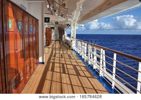CARIBBEAN SEA - FEBRUARY 17 2014 : Crown Princess ship open deck. Crown Princess is a Grand-class cruise ship owned by Princess Cruises