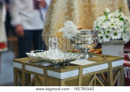 Church supplies for baptism on the table. Ceremony in Christian Church. Interior Of Orthodox Church