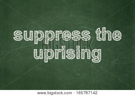 Politics concept: text Suppress The Uprising on Green chalkboard background
