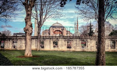 Istanbul, Turkey - 4 March, 2013: View of Hagia Sophia from the Blue Mosque gardens, historic center of Istanbul (UNESCO World Heritage List, 1985), Turkey, 6th century.