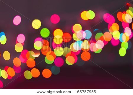 Color light blurred on black background unfocused. Christmas and New Year pattern decorations