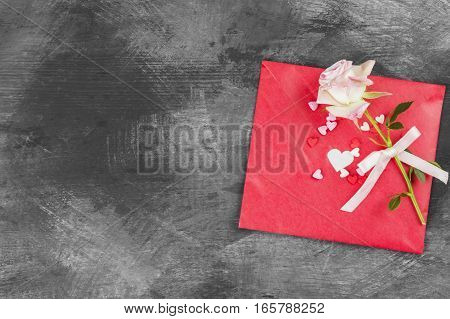The Love Letter Hangs On Rope And A Flower On A Dark Background. The Love Letter Hangs On Rope And A
