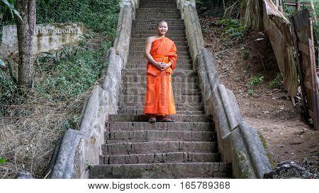 Luang Prabang, Laos - December 3, 2015: Student monks at temple