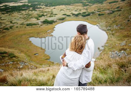 Happy Couple In The Carpathians Mountains
