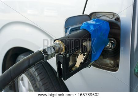 Car Refueling At Petrol Station Close Up.